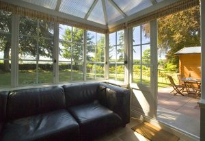 Photo of the Garden Suite's accommodation in Dumfries conservatory overlooking Trigony Hotel's gardens.